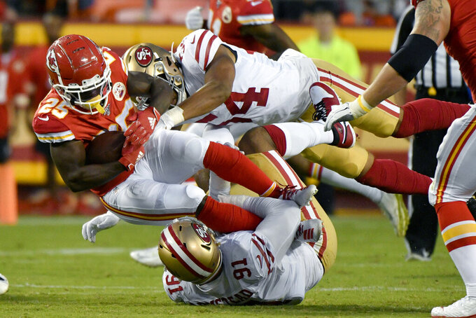 Kansas City Chiefs running back Darwin Thompson (25) is tackled by San Francisco 49ers linebacker Fred Warner (54) and defensive end Arik Armstead (91), during the first half of an NFL preseason football game in Kansas City, Mo., Saturday, Aug. 24, 2019. (AP Photo/Ed Zurga)