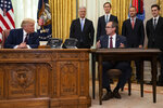President Donald Trump listens to Kosovar Prime Minister Avdullah Hoti during a signing ceremony with Serbian President Aleksandar Vucic, in the Oval Office of the White House, Friday, Sept. 4, 2020, in Washington. (AP Photo/Evan Vucci)