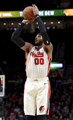 Portland Trail Blazers forward Carmelo Anthony hits a 3-point shot during the second half of an NBA basketball game against the Chicago Bulls in Portland, Ore., Friday, Nov. 29, 2019. The Blazers won 107-103. (AP Photo/Steve Dykes)
