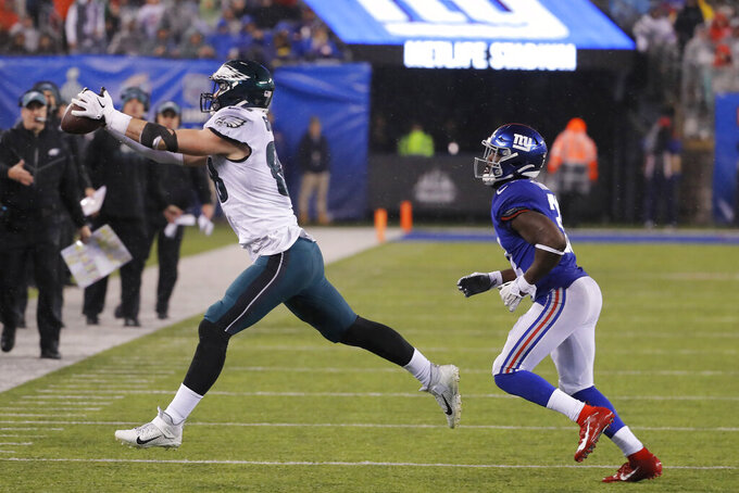 Philadelphia Eagles tight end Dallas Goedert (88) catches the ball in front of New York Giants defensive back Michael Thomas (31) in the second half of an NFL football game, Sunday, Dec. 29, 2019, in East Rutherford, N.J. (AP Photo/Seth Wenig)