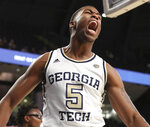 Georgia Tech forward Moses Wright reacts to his slam dunk against Bethune-Cookman during a 68-65 victory in a NCAA college basketball game on Sunday, Dec. 1, 2019, in Atlanta. (Curtis Compton/Atlanta Journal-Constitution via AP)