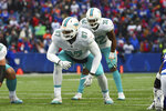 FILE - In this Dec. 17, 2017, file photo, Miami Dolphins offensive tackle Laremy Tunsil (67) lines up against the Buffalo Bills during the second half of an NFL football game in Orchard Park, N.Y. The Houston Texans added six players in four trades this weekend, which included a deal that got Tunsil and receiver Kenny Stills from Miami. (AP Photo/Rich Barnes, File)