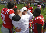 Mississippi players console quarterback John Rhys Plumlee, center, after an NCAA college football game against California in Oxford, Miss., Saturday, Sept. 21, 2019. California won 28-20. (AP Photo/Thomas Graning)