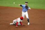 Tampa Bay Rays second baseman Michael Brosseau, top, throws over Philadelphia Phillies' Roman Quinn to complete a double play against batter Andrew McCucthen during the third inning of a baseball game Sunday, Sept. 27, 2020, in St. Petersburg, Fla. (AP Photo/Mike Carlson)