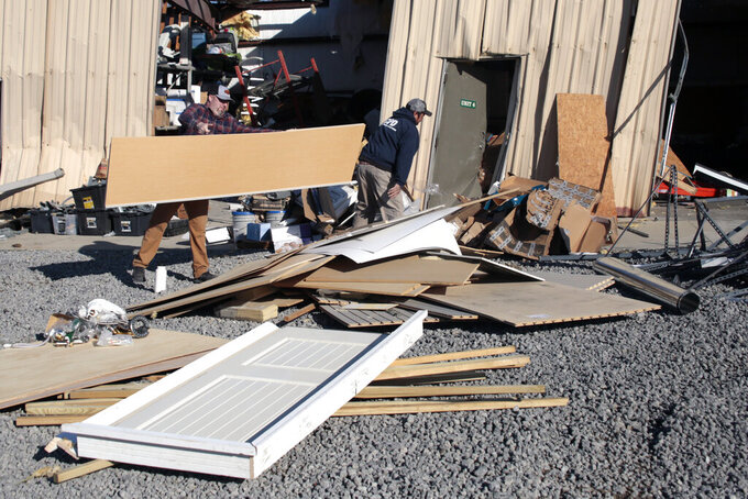 Workers clean up the damage at Ocean Ridge Storage Solutions in Brunswick County, N.C. on Wednesday, Feb. 17, 2021.   Officials say a ferocious tornado struck shortly before midnight Monday just inland from the barrier island of Ocean Isle Beach.(AP Photo/Chris Seward)