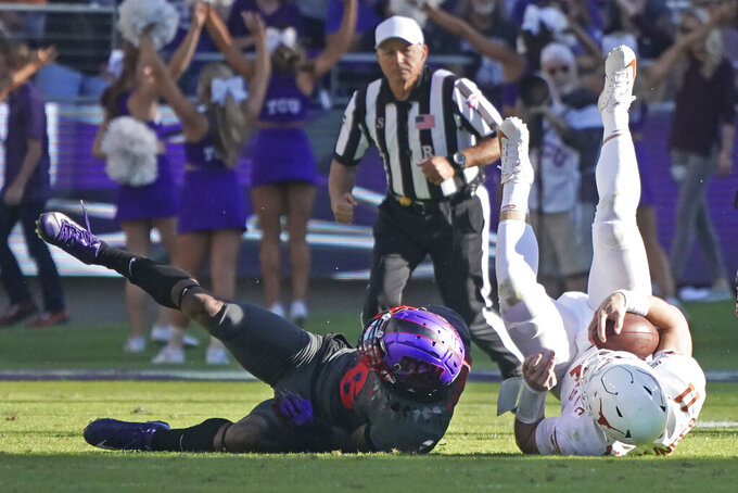 TCU safety Innis Gaines (6) upends Texas quarterback Sam Ehlinger (11) in the second half of an NCAA college football game in Fort Worth, Texas, Saturday, Oct. 26, 2019. (AP Photo/Louis DeLuca)