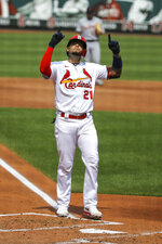 St. Louis Cardinals' Yadier Molina gestures skyward after hitting a two-run home run during the second inning in the first game of a baseball doubleheader against the Detroit Tigers Thursday, Sept. 10, 2020, in St. Louis. Molina is wearing the number 21 in honor of Roberto Clemente. (AP Photo/Scott Kane)