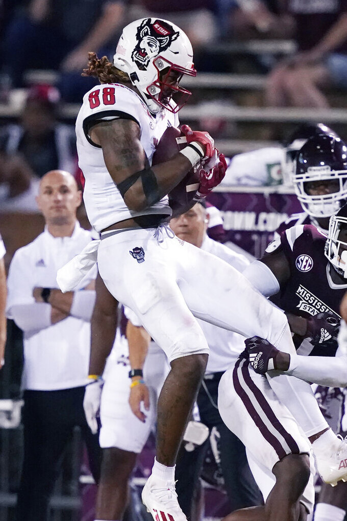 North Carolina State wide receiver Devin Carter (88) catches a pass against Mississippi State during the second half of an NCAA college football game in Starkville, Miss., Saturday, Sept. 11, 2021. (AP Photo/Rogelio V. Solis)