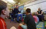 Gov. Gavin Newsom takes questions from second graders during his visit to the Paradise Ridge Elementary School in Paradise, Calif., Wednesday, Aug. 21, 2019. Newsom toured the school and visited with students and teachers that just returned to school last week from the summer break in the community that was ravaged by last year's Camp Fire. New California data shows insurance companies declined to renew nearly 350,000 home insurance policies in areas at high risk for wildfire since the state began collecting data in 2015. (AP Photo/Rich Pedroncelli, Pool)