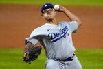 Los Angeles Dodgers starting pitcher Julio Urias works against the Colorado Rockies during the third inning of a baseball game Thursday, Sept. 17, 2020, in Denver. (AP Photo/David Zalubowski)