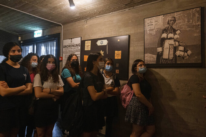 "Israeli students visit at the museum ""From Holocaust to Revival"" on the eve of Holocaust Remembrance Day, in Kibbutz Yad Mordechai, Israel, Wednesday, April. 7, 2021. Holocaust remembrance day is one of the most solemn on Israel's calendar with restaurants and places of entertainment shut down, and radio and TV programming focused on Holocaust documentaries and interviews with survivors. (AP Photo/Tsafrir Abayov)"