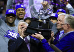 Kansas State head coach Bruce Weber takes hold of the Big 12 trophy following an NCAA college basketball game against Oklahoma in Manhattan, Kan., Saturday, March 9, 2019. Kansas State defeated Oklahoma 68-53. Kansas State shares the regular season title with Texas Tech. (AP Photo/Orlin Wagner)