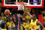 Illinois forward Kipper Nichols (2) goes up for a shot against Maryland forward Jalen Smith (25) during the second half of an NCAA college basketball game, Saturday, Dec. 7, 2019, in College Park, Md. Maryland won 59-58. (AP Photo/Julio Cortez)