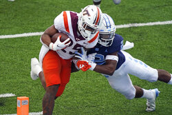 Virginia Tech running back Khalil Herbert (25) scores a touchdown as North Carolina defensive back Don Chapman (2) tries to tackle during the first half of an NCAA college football game in Chapel Hill, N.C., Saturday, Oct. 10, 2020. (AP Photo/Gerry Broome)