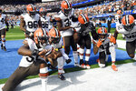 Cleveland Browns players celebrate after a fumble recovery on a kickoff during the first half of an NFL football game against the Los Angeles Chargers Sunday, Oct. 10, 2021, in Inglewood, Calif. (AP Photo/Kevork Djansezian)