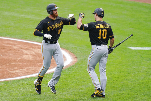 Pittsburgh Pirates' Colin Moran (19) celebrates with teammate Bryan Reynolds (10) after hitting a home run in the first inning of a baseball game against the Cincinnati Reds at Great American Ballpark in Cincinnati, Thursday, Aug. 13, 2020. (AP Photo/Bryan Woolston)