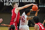 Wisconsin's Tyler Wahl, left, tries to block Rutgers' Jacob Young (42) during the first half of an NCAA college basketball game Friday, Jan. 15, 2021, in Piscataway, N.J. (AP Photo/Seth Wenig)