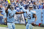 Tennessee Titans inside linebacker Jayon Brown (55) celebrates with Rashaan Evans (54) after Brown intercepted a pass in the end zone against the Houston Texans in the second half of an NFL football game Sunday, Dec. 15, 2019, in Nashville, Tenn. (AP Photo/James Kenney)