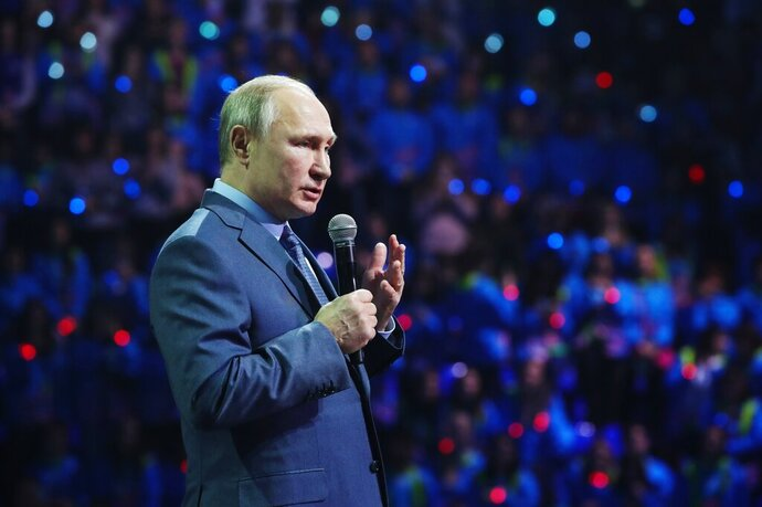Russian President Vladimir Putin speaks during the International Volunteer Forum at the Olympic Park in Sochi, Russia, Dec. 5, 2019. (Shamil Zhumatov/Pool Photo via AP)