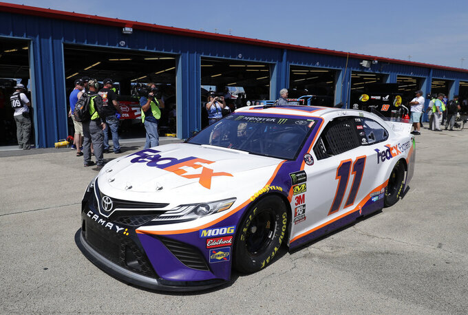 Denny Hamlin drives to the track during a practice for the NASCAR Sprint Cup Series auto race at Chicagoland Speedway in Joliet, Ill., Saturday, June 29, 2018. (AP Photo/Nam Y. Huh)