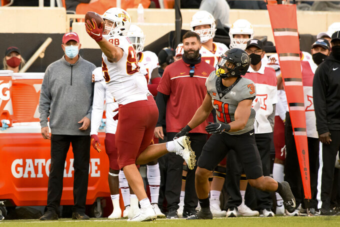 Oklahoma State safety Kolby Harvell-Peel (31) chases after Iowa State tight end Charlie Kolar (88) as he catches a 9-yard pass near the sidelines during the last half of an NCAA college football game Saturday, Oct. 24, 2020, in Stillwater, Okla. (AP Photo/Brody Schmidt)
