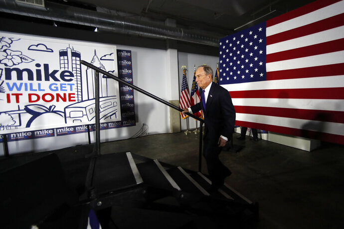 Democratic Presidential candidate and former New York City Mayor Michael Bloomberg step on stag to speak during a rally Friday, Jan. 10, 2020, in Atlanta. (AP Photo/John Bazemore)