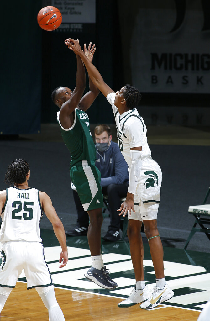 Michigan State's Marcus Bingham Jr., right, blocks a shot by Eastern Michigan's Miles Gibson during the second half of an NCAA college basketball game Wednesday, Nov. 25, 2020, in East Lansing, Mich. Michigan State won 83-67. (AP Photo/Al Goldis)