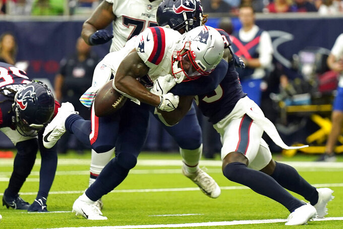 New England Patriots running back Damien Harris, left, fumbles the ball at the goal line as he is hit by Houston Texans cornerback Terrance Mitchell during the first half of an NFL football game Sunday, Oct. 10, 2021, in Houston. The Texans recovered the fumble. (AP Photo/Eric Christian Smith)