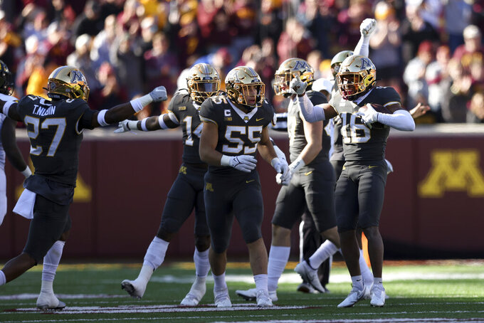 Minnesota defensive back Coney Durr (16) celebrates on the field after intercepting the ball during an NCAA college football game against Maryland, Saturday, Oct. 23, 2021, in Minneapolis. (AP Photo/Stacy Bengs)