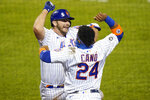 New York Mets' Pete Alonso, left, celebrates with teammate Robinson Cano after hitting a home run during the fourth inning of a baseball game against the Tampa Bay Rays Tuesday, Sept. 22, 2020, in New York. (AP Photo/Frank Franklin II)