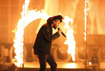 """FILE - In this Sunday, Nov. 22, 2015, file photo, the Weeknd performs at the American Music Awards at the Microsoft Theater in Los Angeles. The Weeknd had the No. 1 song of 2020 but """"Blinding Lights"""" was not nominated for a Grammy Award.  (Photo by Matt Sayles/Invision/AP, File)"""