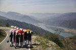 School girls walk along a road overlooking Tehri Dam in the northern Indian state of Uttarakhand, Monday, May 13, 2019. The Tehri Dam built on the Bhagirathi river is India's highest dam and supplies power and water to numerous Indian towns and cities. The Bhagirathi river is one of the two sources that form the River Ganges, the other being the river Alaknanda. (AP Photo/Altaf Qadri)