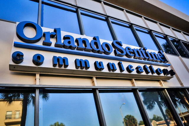 This Tuesday, May 6, 2014, photo shows the exterior of the Orange Avenue side of the Orlando Sentinel building in Orlando, Fla. In an announcement Wednesday, Aug. 12, 2020, Tribune Publishing Company said it's closing the newsrooms of five newspapers including The Daily News in Manhattan, the Orlando Sentinel and The Capital Gazette in Annapolis, Maryland. The Chicago-based newspaper chain said the decision was made as the company evaluates its real estate needs in light of health and economic conditions related to the coronavirus pandemic. (Joshua C. Cruey/Orlando Sentinel via AP)