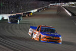 Sheldon Creed (2) leads during a NASCAR truck series auto race at World Wide Technology Raceway Friday, Aug. 20, 2021, in Madison, Ill. (AP Photo/Jeff Roberson)