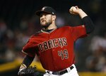 Arizona Diamondbacks starting pitcher Alex Young throws against the Milwaukee Brewers during the first inning of a baseball game Sunday, July 21, 2019, in Phoenix. (AP Photo/Ross D. Franklin)