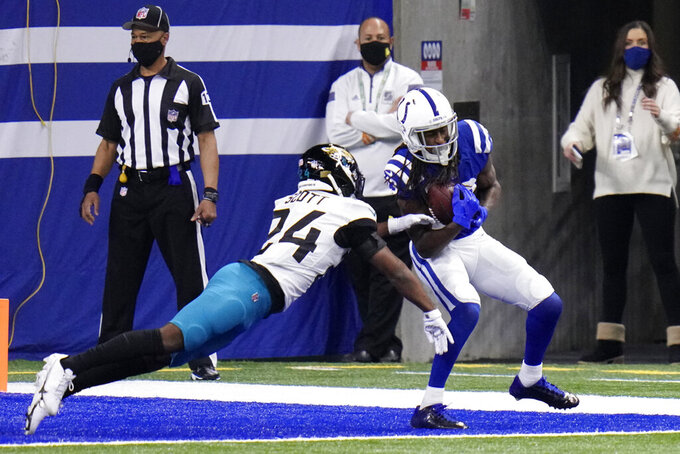 Indianapolis Colts' T.Y. Hilton (13) catches a pass against Jacksonville Jaguars' Josiah Scott (24) for a two-point conversion during the second half of an NFL football game, Sunday, Jan. 3, 2021, in Indianapolis. (AP Photo/AJ Mast)