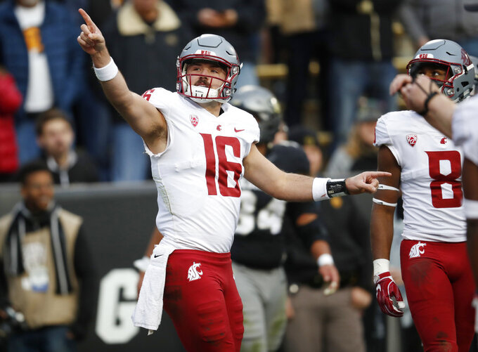 Washington State quarterback Gardner Minshew points to the scoreboard to call for a review of his run that was ruled for a touchdown in the second half of an NCAA college football game against Colorado Saturday, Nov. 10, 2018, in Boulder, Colo. Washington State won 31-7. (AP Photo/David Zalubowski)
