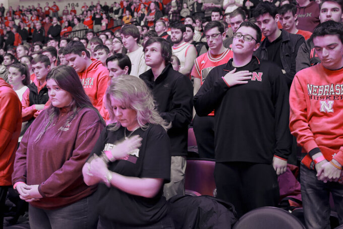 Fans observe a moment of silence to honor deceased basketball great Kobe Bryant before an NCAA college basketball game between Nebraska and Michigan, in Lincoln, Neb., Tuesday, Jan. 28, 2020. (AP Photo/Nati Harnik)