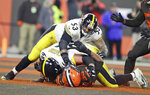 Cleveland Browns defensive end Myles Garrett (95) is punched by Pittsburgh Steelers center Maurkice Pouncey (53) and tackled by offensive guard David DeCastro (66) during the second half of an NFL football game Thursday, Nov. 14, 2019, in Cleveland. The Browns won 21-7. (AP Photo/Ron Schwane)