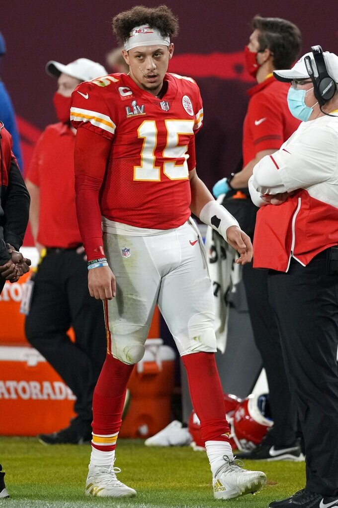 Kansas City Chiefs quarterback Patrick Mahomes walks on the sideline during the second half of the NFL Super Bowl 55 football game against the Tampa Bay Buccaneers Sunday, Feb. 7, 2021, in Tampa, Fla. (AP Photo/Chris O'Meara)