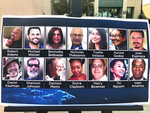 Photos of the 14 victims killed in a 2015 terror attack in San Bernardino, Calif., are displayed outside federal court in Riverside, Calif., Friday, Oct. 23, 2020. Enrique Marquez Jr. was sentenced to 20 years in prison Friday for supplying the rifles used by his friend Syed Rizwan Farook and Farook's wife to open fire on a meeting and holiday gathering of San Bernardino County employees who worked with Farook. After killing 14 people and wounding 22, Farook and his wife were killed in a gunbattle with authorities. (AP Photo/Stefanie Dazio)