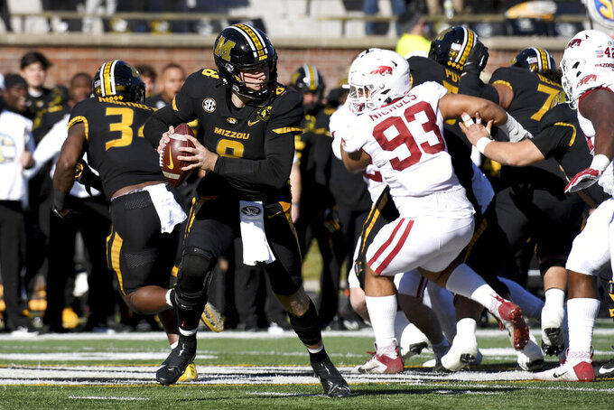 Missouri quarterback Connor Bazelak drops back to pass during the first half of an NCAA college football game against Arkansas Saturday, Dec. 5, 2020, in Columbia, Mo. (AP Photo/L.G. Patterson)