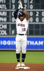 Houston Astros' Tony Kemp reacts after hitting a two-run double during the fourth inning of the team's baseball game against the Milwaukee Brewers, Wednesday, June 12, 2019, in Houston. (AP Photo/Eric Christian Smith)