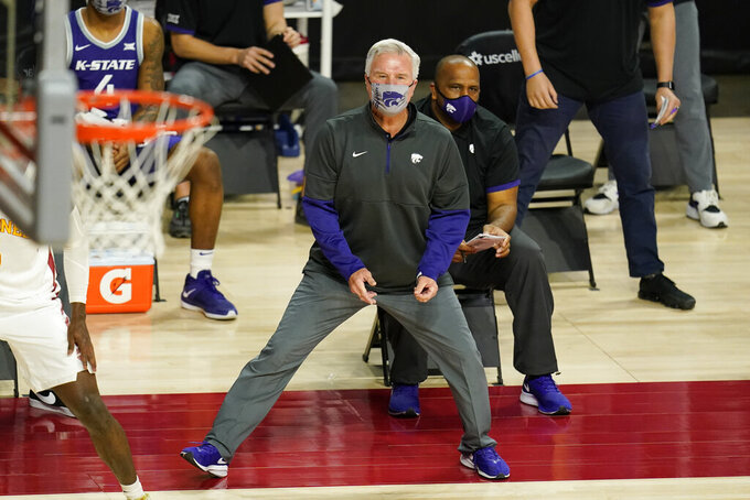 Kansas State head coach Bruce Weber watches from the bench during the first half of an NCAA college basketball game against Iowa State, Tuesday, Dec. 15, 2020, in Ames, Iowa. (AP Photo/Charlie Neibergall)