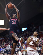 Louisville center Steven Enoch (23) grabs a rebound over Boston College forward Steffon Mitchell (41) during the second half of an NCAA college basketball game in Boston, Wednesday, Feb. 27, 2019. (AP Photo/Charles Krupa)