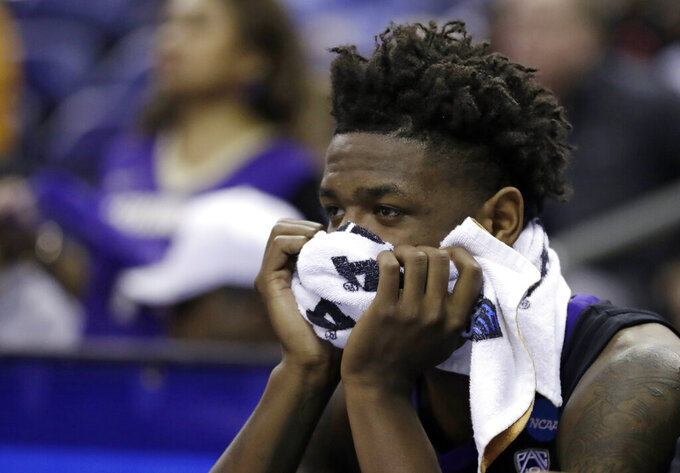 Washington's Nahziah Carter watches from the bench in the final minutes of the second half against North Carolina during a second-round men's college basketball game in the NCAA Tournament in Columbus, Ohio, Sunday, March 24, 2019. (AP Photo/Tony Dejak)
