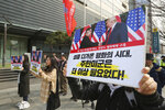 In this March 2, 2019, photo, South Korean protesters with banners showing photos of U.S. President Donald Trump and North Korean leader Kim Jong Un stage a rally to denounce policies of the United States on North Korea in Seoul, South Korea. North Korean leader Kim will soon make a decision on whether to continue diplomatic talks and maintain the country's moratorium on missile launches and nuclear tests, a senior North Korean official said on Friday, March 15, 2019, noting the U.S. threw away a golden opportunity at the recent summit between their leaders. The signs read: