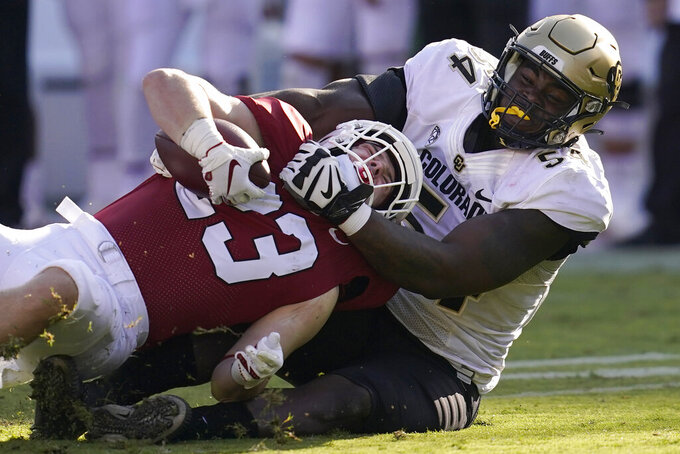Colorado defensive end Terrance Lang, right, tackles Stanford running back Casey Filkins during the second half of an NCAA college football game in Stanford, Calif., Saturday, Nov. 14, 2020. (AP Photo/Jeff Chiu)