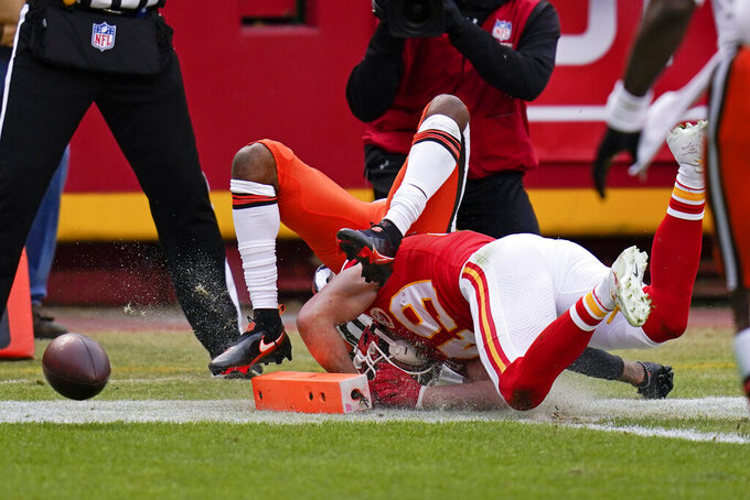 Cleveland Browns wide receiver Rashard Higgins, rear, fumbles the ball as he is tackled by Kansas City Chiefs safety Daniel Sorensen (49) during the first half of an NFL divisional round football game, Sunday, Jan. 17, 2021, in Kansas City. (AP Photo/Jeff Roberson)
