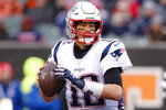 FILE - In this Dec. 15, 2019, file photo, New England Patriots quarterback Tom Brady looks to pass in the second half of an NFL football game against the Cincinnati Bengals in Cincinnati. Finding a right tackle to help protect Brady is one of the Tampa Bay Buccaneers top priorities. (AP Photo/Gary Landers, File)